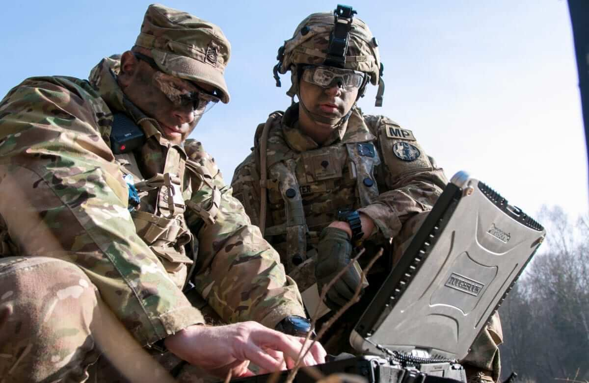 Sgt. 1st Class Joseph Rombold (left), an observer coach at Hohenfels Training Area, Germany, shows Spc. William Ritter (right), a military policeman with 287th Military Police Company, 97th Military Police Battalion, 89th Military Police Brigade, Fort Riley, Kansas, how to properly set up the system to operate the RQ-11 Raven, a small unmanned aerial system (sUAS), during Allied Spirit VIII at Hohenfels, Germany, Jan. 26, 2018. Roughly 4,100 troops from 10 nations are participating in Allied Spirit VIII, a multinational training exercise designed to test participants' readiness and capabilities. (U.S. Army photo by Spc. Dustin D. Biven / 22nd Mobile Public Affairs Detachment)